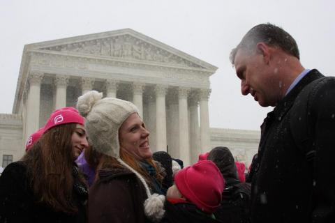 Scott rallying with advocates for access to contraceptives outside the Supreme Court this morning.